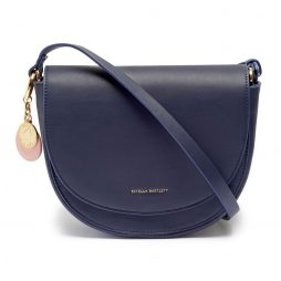 Estella Bartlett Navy Saddle Bag with Blush Bag Tag and Coin Charm